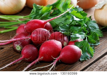 Radishes Parsley And Onions On A Kitchen Table