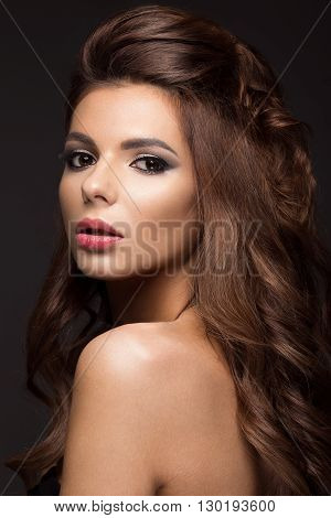 Beautiful woman with evening make-up, long straight hair . Smoky eyes. Fashion photo. Portrait shot in studio