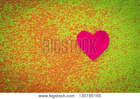 red heart felt shape in small yellow and orange beads