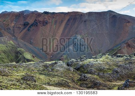 Summer morning in the National Park Landmannalaugar, Iceland. The picturesque valley surrounded by rhyolite mountains