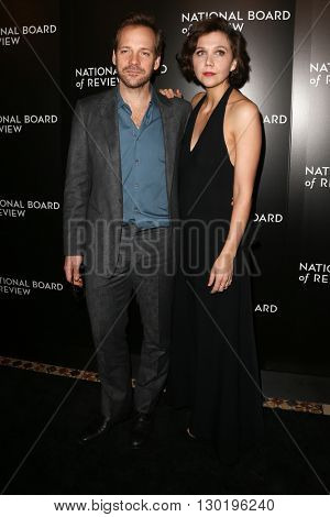 NEW YORK-JAN 5: Actors Peter Peter Sarsgaard (L) and Maggie Gyllenhaal attend the 2015 National Board of Review Gala at Cipriani 42nd Street on January 5, 2016 in New York City.