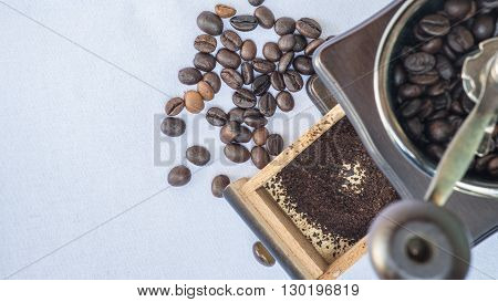 Fresh coffee beans with the equipment for grinding