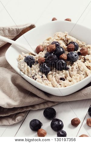 Food. Delicious oatmeal porridge with blueberries