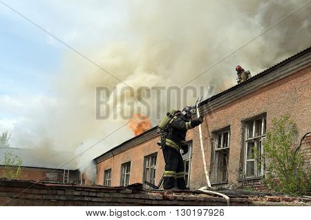 NOVOSIBIRSK RUSSIA - MAY 18 2016 Fire on the territory of a military unit in the city of Novosibirsk