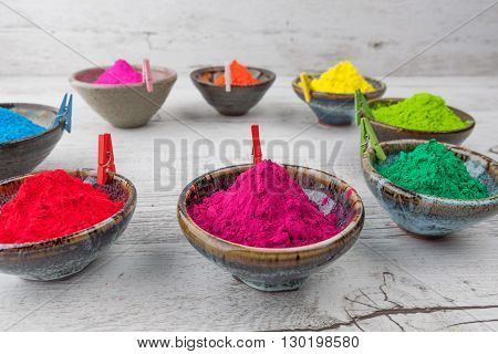 Holi Powder In Cups Arranged In Circle With Pegs