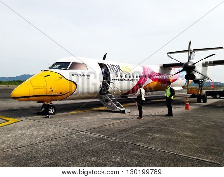 RANONG THAILAND - MAY 8 2016: Unidentified group of people walked to Nok Air airplane in Ranong airport on May 8 2016. Nok Air is one of the biggest low cost airline in Thailand