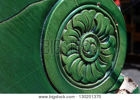 The Chinese symbol - the cosmic balance of Yin and Yang. Old tiles. China.