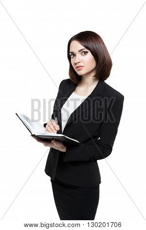thoughtful young beautiful business woman holding a diary and a pen isolated on white background
