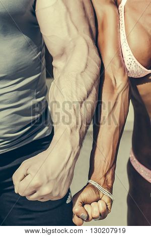 Man And Woman Show Arms