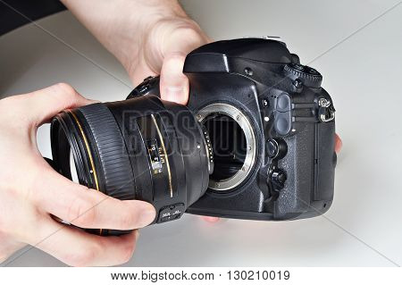 Photographer With Big Lens And Digital Slr Camera