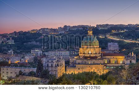 Sunset on The Buon Consiglio church in Naples imitation of St. Peter in the Vatican. In backgroud the Vomero Hill