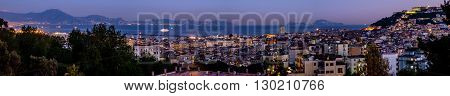 Sunset on Naples cityscape with Capri and Sorrento coast in background. Italy