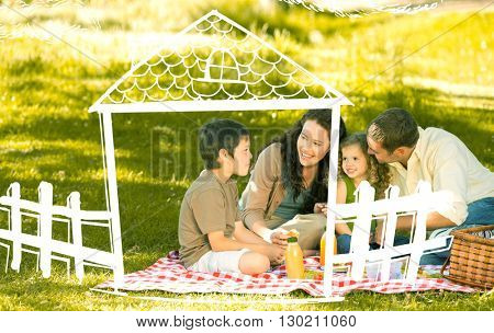 Family picnicking together against hand drawn house
