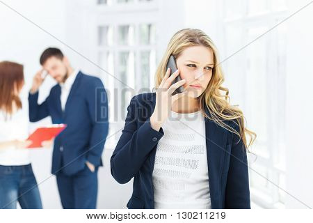 Portrait of businesswoman talking on mobile phone in office