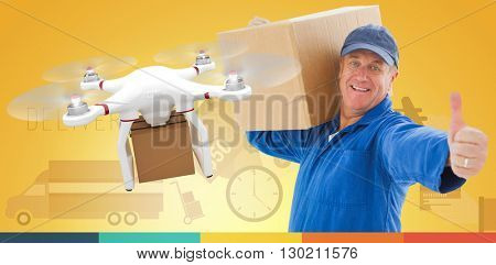 Happy delivery man holding cardboard box against drone holding a cardboard