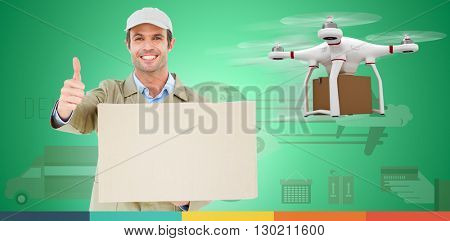 Happy delivery man gesturing thumbs up while carrying cardboard box against digital image of a drone holding a cardboard