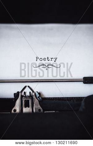 Poetry message on a white background against close-up of typewriter