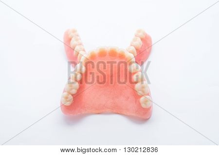 Full denture isolate on white background .