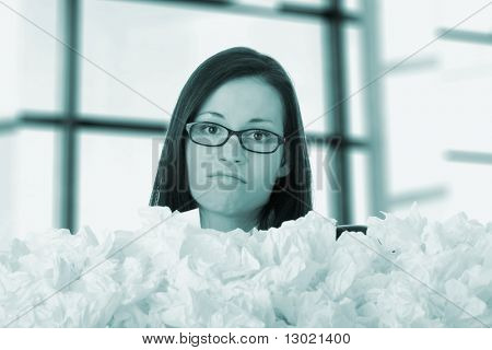 Young businesswoman in office with lot of tissues around - flue concept
