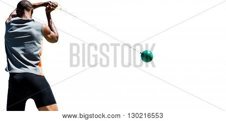 Rear view of sportsman practising hammer throw