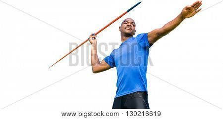 Concentrated sportsman practising javelin throw