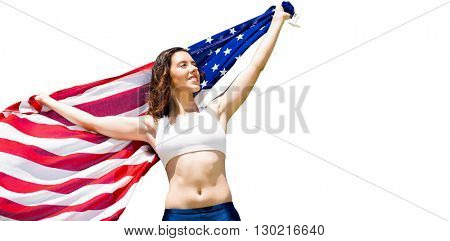 Happy sportswoman posing with an american flag