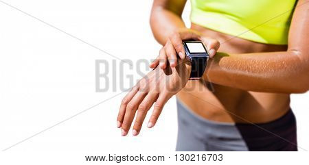Close up on a sportswoman wearing a connected watch