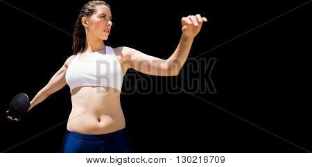 Front view of sportswoman practising discus throw