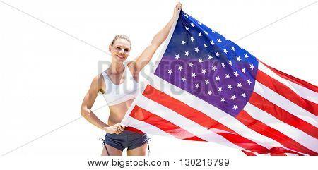 Happy sportswoman holding an american flag