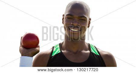 Portrait of happy sportsman is holding a shot put