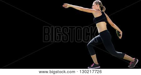 Profile view of sportswoman practising discus throw