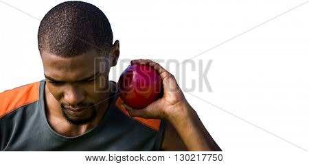 Portrait of sportsman practising shot put
