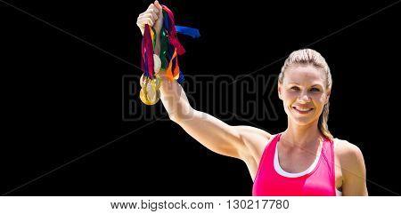 Portrait of happy sportswoman raising her medals