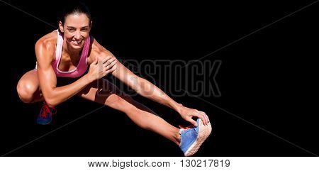 Portrait of happy sportswoman is stretching her muscle