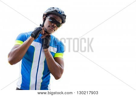 Athletic man putting his cycling helmet