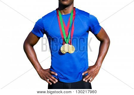 Portrait of athletic man chest holding gold medals