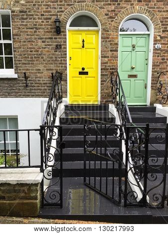 LONDON - MAY 18: Smart house facades with yellow and green front doors on May 18, 2016 in Hampstead, London, UK.