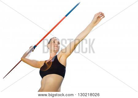 Low angle view of sportswoman is practising javelin throw