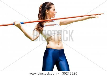 Front view of sportswoman is practising javelin throw