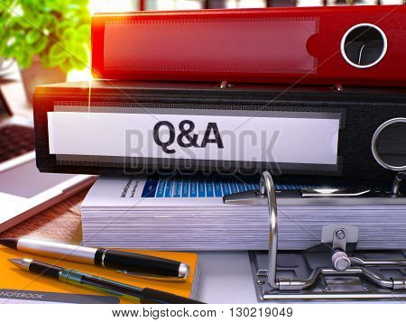 Black Office Folder with Inscription Question and Answer on Office Desktop with Office Supplies and Modern Laptop. Question and Answer Business Concept on Blurred Background. 3D.