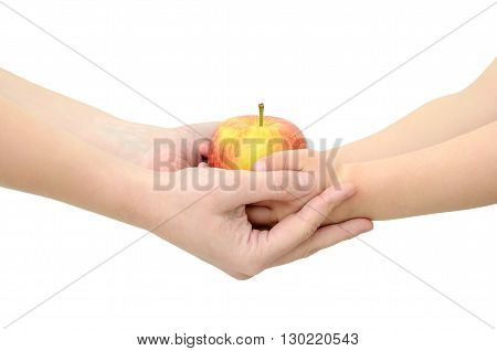 Children's Hands Give An Apple Isolated On White Background