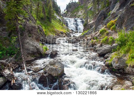 Mystic Falls on the Little Firehole River beautifully curly between rocky shores Yellowstone National Park