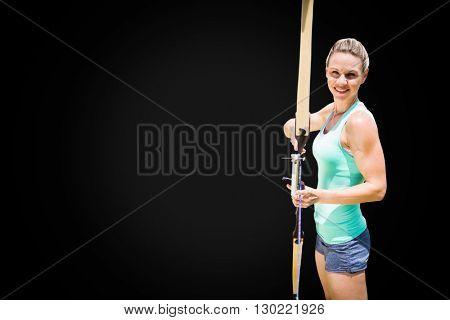 Portrait of sportswoman is practising archery