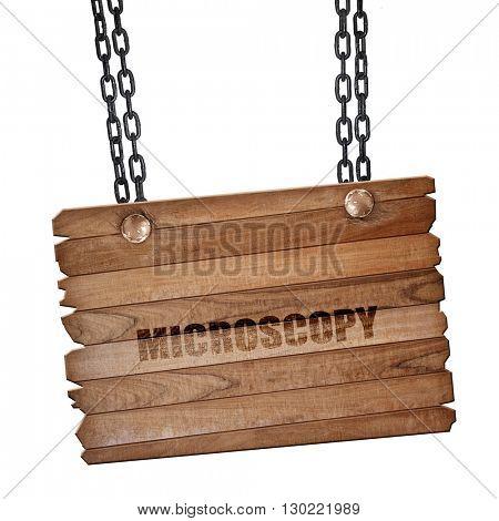 microscopy, 3D rendering, wooden board on a grunge chain