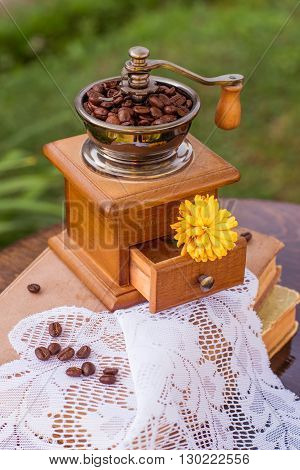 beans of coffee on vintage wooden background