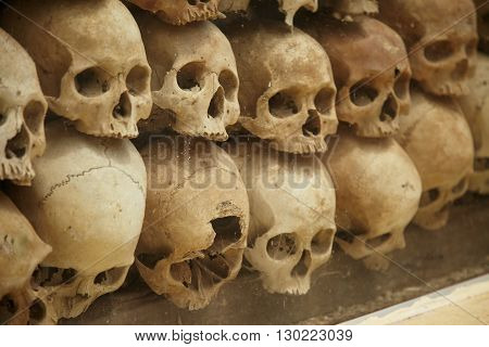 Wall of old human skulls in Thailand.
