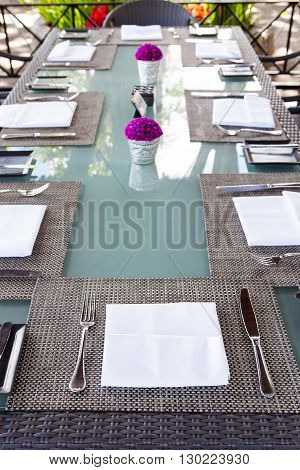 Restaurant table setting Copy space Outdoor summer tropical background