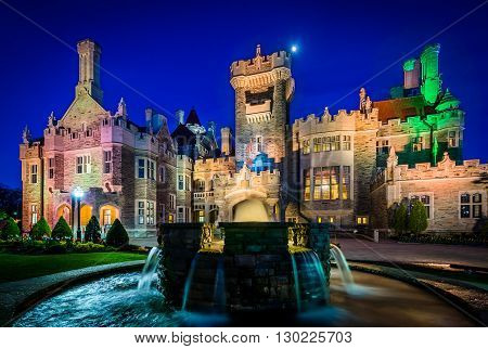 Fountain And Casa Loma At Night In Midtown Toronto, Ontario.