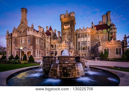 Fountain And Casa Loma At Twilight, In Midtown Toronto, Ontario.