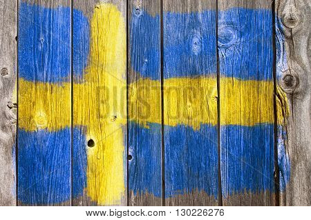 swedish colors painted on old wooden wound
